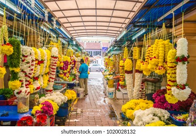 Kuala Lumpur, Malaysia - Feb 7,2017 : Colorful garlands flower selling in the market stalls in Brickfields Little India in KL, people can seen exploring around it.