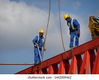 KUALA LUMPUR, MALAYSIA -FEBRUARY 03, 2017: Construction workers working at height at the construction site. They are requested to wear appropriate safety gear to prevent bad happen to them.