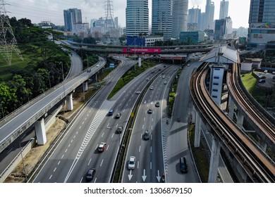 KUALA LUMPUR, MALAYSIA - FEBRUARY 05, 2019. An aerial view of controlled traffic flow at Federal Highway in Kuala Lumpur, Malaysia.