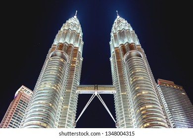 KUALA LUMPUR, MALAYSIA - February 05, 2013. Illuminated Petronas Twin Towers on night sky background.