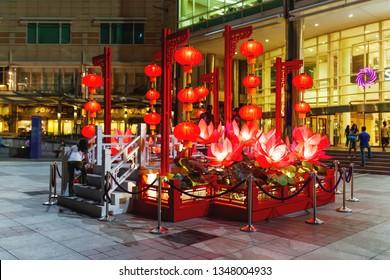 KUALA LUMPUR, MALAYSIA - February 05, 2013. Red illuminated decorations in front of Petronas Twin Towers. Chinese decorative lanterns for Chinese New Year celebration.