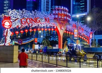 KUALA LUMPUR, MALAYSIA - February 05, 2013. Skyscraper building of Bank Simpanan Nasional  (National Savings Bank). Decorative arch with Chinese New Year greeting.
