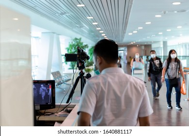Kuala Lumpur, Malaysia, February 06 2020: Airport medical staff detect incoming passengers body temperature with thermal camera equipment prevent the spread of the coronavirus outbreaks