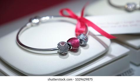 Kuala Lumpur, Malaysia - February 14, 2018 : New design Pandora bracelet charms, Selective focus with blur bacground.