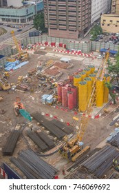 KUALA LUMPUR, MALAYSIA - FEBRUARY 15, 2013: An aerial view of heavy cranes starting work early in the morning on a massive construction site in downtown Kuala Lumpur.