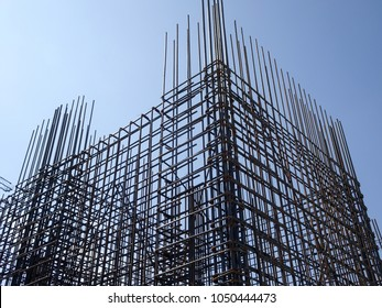 KUALA LUMPUR, MALAYSIA -FEBRUARY 16, 2018: Steel reinforcement bar and timber form works at construction site. Be part of the reinforced concrete structure. It is tied together using tiny wire before