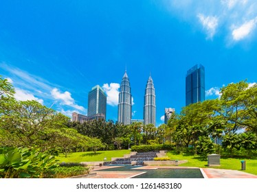 KUALA LUMPUR, MALAYSIA - FEBRUARY 16, 2018: View of the Petronas twin towers against a blue sky. Copy space for text