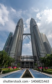 KUALA LUMPUR, MALAYSIA - February 18 2019: Petronas Twin Towers in Kuala Lumpur, Malaysia. Petronas Towers are twin skyscrapers and were tallest buildings in the world until 2004