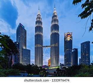 KUALA LUMPUR, MALAYSIA - February 19, 2015: Petronas Twin Towers at KLCC City Center, colorful musical fountain at night. The Petronas Commercial offices and tourist attraction skyscraper