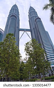 Kuala Lumpur / Malaysia - February 19, 2015: Petronas Twin Towers world's tallest twin tower. The Menara Berkembar Petronas Commercial offices and tourist attraction skyscraper 88-floor.