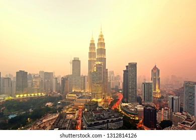 KUALA LUMPUR, MALAYSIA - FEBRUARY 1Oth, 2019 : Sunset view over Kuala Lumpur city skyline. Petronas Twin Towers also known as KLCC is the tallest building in Malaysia
