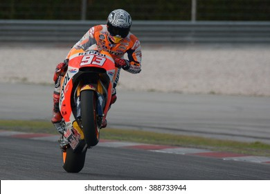 KUALA LUMPUR - MALAYSIA, FEBRUARY 2: Marc Marquez from Repsol Honda Team does a wheelie during  2016 Sepang Test MotoGP of Sepang on February 2, 2016