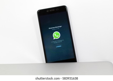 KUALA LUMPUR, MALAYSIA - FEBRUARY 20th, 2017: A hand holding a phone with a visible whatsApp apps Icon on the phone. WhatsApp Messenger is a cross-platform instant messaging subscription service