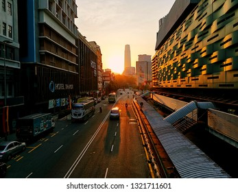 Kuala Lumpur, Malaysia- February 24, 2019: Plenty of vehicles on the road at Pudu Sentral during sunrise.