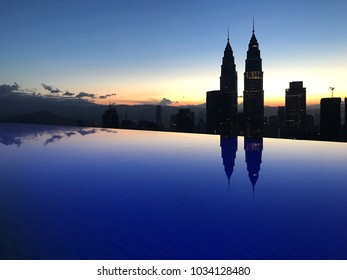 Kuala Lumpur, Malaysia - February 25, 2018: Sunrise scene at Kuala Lumpur city skyline, overlooking the famous KLCC Petronas Twin Towers. As view from high level sky deck pool.