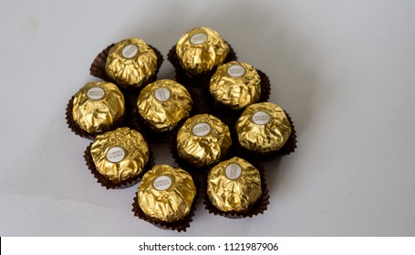 KUALA LUMPUR, MALAYSIA - February 25, 2018 : Ferrero Rocher premium chocolate sweets produced by the Italian chocolatier Ferrero SpA. are sold in over 40 countries in amount of about 3.6 billion a yea