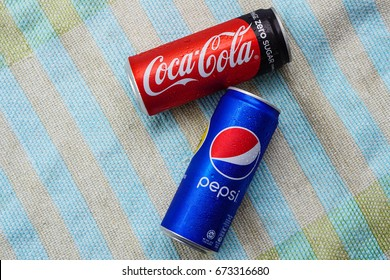 KUALA LUMPUR, MALAYSIA - FEBRUARY 26TH, 2017. Coca-Cola and Pepsi drinks on color back ground