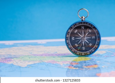Kuala Lumpur, MALAYSIA FEBRUARY 27, 2019: Compass on world map background. Selective focus, Business and Travel Concept