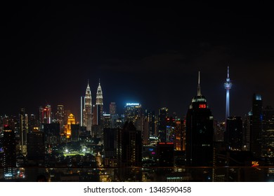 Kuala Lumpur, Malaysia - February 27, 2019: View to the skyline with Petronas Towers from Infinity Pool at night.