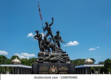 Kuala Lumpur, Malaysia - February 27, 2019: Malaysia's National Monument (15 meters) is identified as the largest freestanding bronze sculptures grouping in the world.