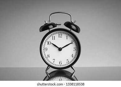 Kuala Lumpur, Malaysia - February 28, 2019 : Alarm Clock on black and white background with selective focus and crop fragment. Business and Copy space concept