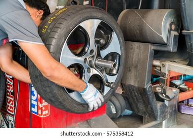 KUALA LUMPUR, MALAYSIA - FEBRUARY 3, 2017: Unidentified mechanic repairing tire at Kuala Lumpur, Malaysia