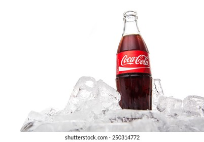 KUALA LUMPUR, MALAYSIA - FEBRUARY 5TH, 2015. Coca Cola soft drink on ice. Coca Cola drinks are produced and manufactured by The Coca-Cola Company, an American multinational beverage corporation