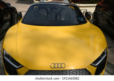 Kuala Lumpur, Malaysia - February 7, 2021 : Super-sport yellow car, Audi R8 open a roof at the parking.
