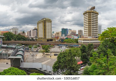 Kuala Lumpur, Malaysia - February 7, 2016: Panoramic view of the tourist district near Chinatown in Kuala Lumpur. Cars and public transport move along Jalan Pudu Street in the city center