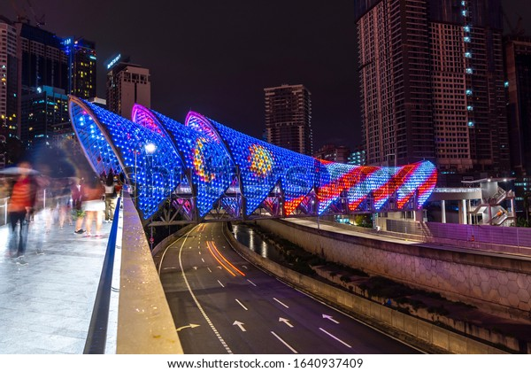 KUALA LUMPUR, MALAYSIA, FEBRUARY 9 2020 : A newly built pedestrian bridge named Lintasan Saloma near Kuala Lumpur Petronas Twin Tower (KLCC). This bridge have unique design based Malay culture