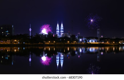KUALA LUMPUR, MALAYSIA - JAN 1: Colorful Fireworks spark during New Year eve at the Petronas Twin Tower on January 1, 2011 in Kuala Lumpur Malaysia. This marks the beginning of a new calendar year.