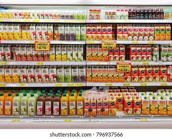 KUALA LUMPUR, MALAYSIA - JAN 12, 2017: Rows of shelf at Village Grocer Hypermarket, local shopping chain that offers imported FMCG, chilled frozen milk yogurt beverage organic marketing experience