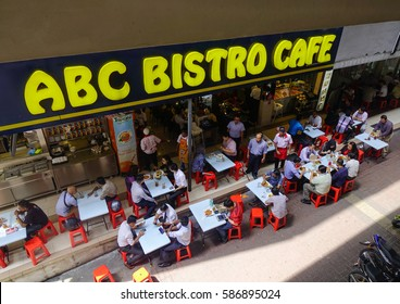 Kuala Lumpur, Malaysia - Jan 17, 2017. People at the Bistro Cafe in Kuala Lumpur, Malaysia. Kuala Lumpur is the most populous city in Malaysia, with a population of 1.7 million in 2015.
