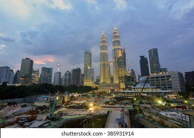 KUALA LUMPUR, MALAYSIA - JAN 19: Petronas Twin Towers at twilight on Jan 19, 2015 in Kuala Lumpur. Petronas Twin Towers are twin skyscrapers and were tallest buildings in the world from 1998 to 2004.