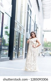 Kuala Lumpur, Malaysia - Jan 2019 : Lifestyle portrait of a beautiful Kazakhstan girl wearing stylish bright outfit posing in urban environments. Lifestyle fashion portraiture concept.