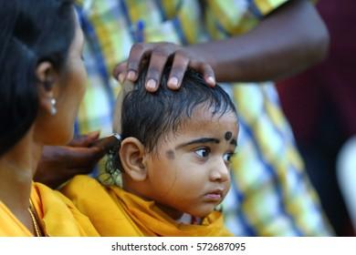 KUALA LUMPUR, MALAYSIA -JAN 24, 2016 Hindus kids devotees were shaved his head before following the ceremony Thaipusam at Batu Caves, Kuala Lumpur - Malaysia.