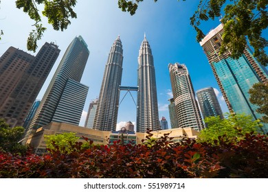 KUALA LUMPUR, MALAYSIA - JAN 9, 2017: Cloudscape view of the Petronas Twin Towers at KLCC City Centre. The most popular tourist destination in Malaysian capital