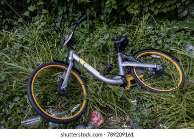 KUALA LUMPUR, MALAYSIA - JANUARY 05, 2018. An abandoned and vandalize sharing city bike known as OBike which are the public bicycle rental service provided in Malaysia.
