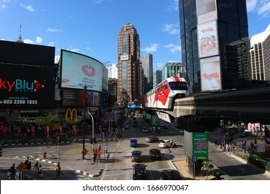 Kuala Lumpur, Malaysia - January 1 2020: View from monorail station at Bukit Bintang in Kuala Lumpur during late afternoon. KL Monorail train is leaving Bukit Bintang Monorail Station.