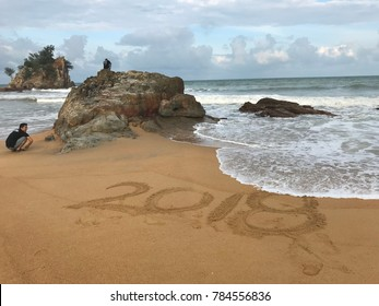 Kuala Lumpur, Malaysia: January 1, 2018:  Happy New Year 2018  written on the golden sandy beach at Pantai Kemasik, Kemaman, Terengganu. Malaysia. New year 2018 is coming concept