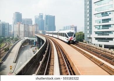 KUALA LUMPUR, MALAYSIA, January 10, 2017: A RapidKL LRT train pulls into Sentral station in Kuala Lumpur, Malaysia. RapidKL's transport network serves approximately 790,000 passengers daily.
