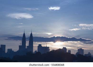 KUALA LUMPUR, MALAYSIA - JANUARY 10, 2017 : A majestic silhouette Golden Blue Hour sunrise view a Kuala Lumpur City Center (KLCC) over a cityscape and a cloudy day