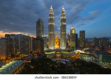 Kuala Lumpur, Malaysia - January 13, 2015 : Petronas twin tower KLCC at sunset blue hour seen from the Traders sky bar hotel
