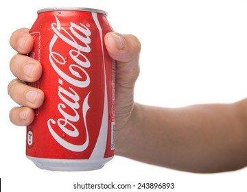 KUALA LUMPUR, MALAYSIA - JANUARY 13TH, 2015. Holding a can of Coca Cola. Coca Cola drinks are produced and manufactured by The Coca-Cola Company, an American multinational beverage corporation.