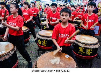 KUALA LUMPUR, MALAYSIA - JANUARY 14, 2017: Action of students during drum performance in the program A Flourish of Hundreds Drums. Selective focus.