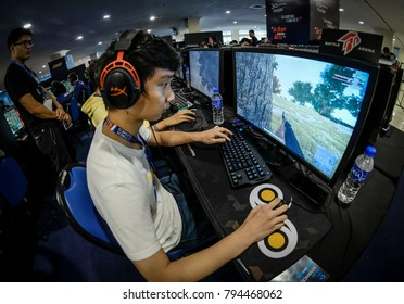 Kuala Lumpur, Malaysia - January 15, 2018: Gamers Play in Multiplayer PC Video Games. PUBG is e-games famous in the world.