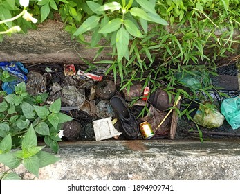 Kuala Lumpur Malaysia. January 16 2021. Rubbish consist of shoes, food packaging, can drink, Styrofoam, plastic bags in the gutter clogging the drainage.