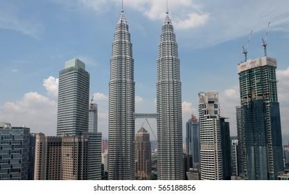 KUALA LUMPUR, MALAYSIA - JANUARY 18, 2017: KLCC Petronas Twin Towers from Kuala Lumpur Convention Centre, high angle view, Sunny day and blue sky.