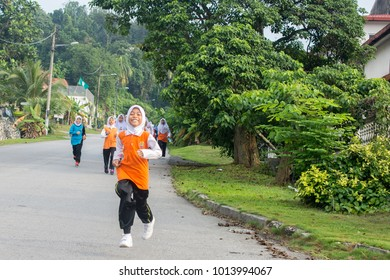 KUALA LUMPUR, MALAYSIA - JANUARY 20, 2018: Group of primary school athletes running a cross country race