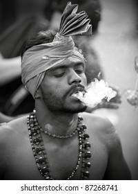 KUALA LUMPUR, MALAYSIA - JANUARY 20: Hindu devotee in traditional costume in a trance on Thaipusam on January 20, 2011 in Batu Cave to show devotion to Lord Murugan victory over the demon Soorapadman
